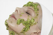 Woman with Acne Mask